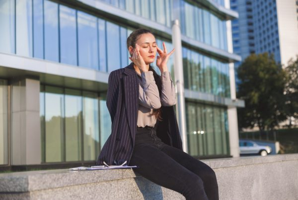 Stressed business woman outside of building