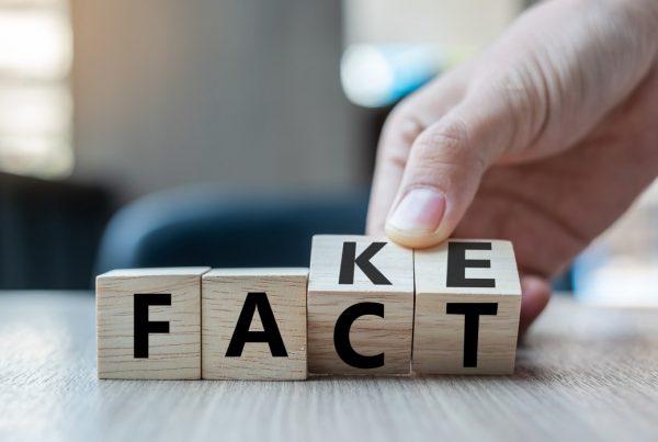 Letter blocks spelling fact/fake